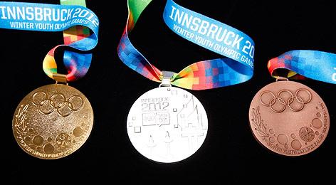 Beide Seiten der olympischen Medaille